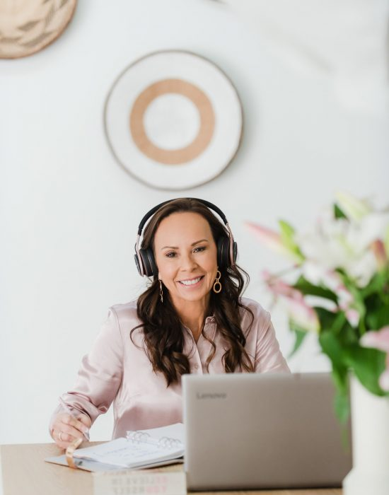 Online Hypnotherapist - woman with headohones and silver laptio